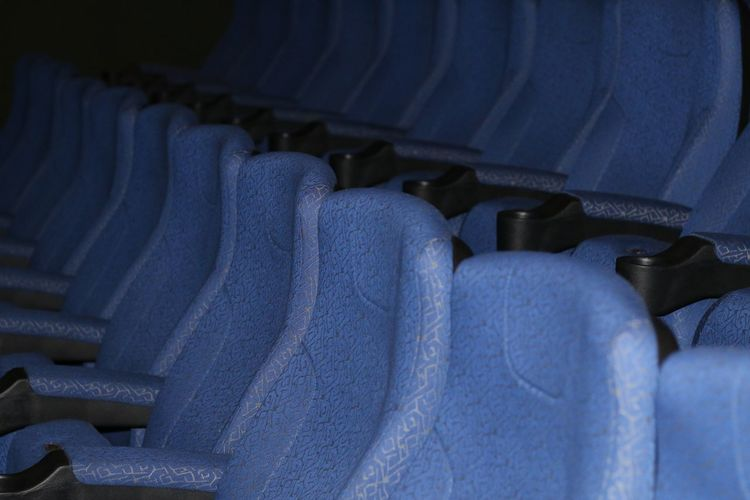 Cinema Cinema In Your Life Chair Empty Macro Rows Of Things Blue Urban Deceptively Simple Urban Lifestyle Still Life EyeEm Gallery EyeEm Best Shots Close-up Learn & Shoot: After Dark Darkness And Light Light And Shadow From My Point Of View Color Palette Learn & Shoot: Layering Composition Pivotal Ideas Beautifully Organized Neon Life