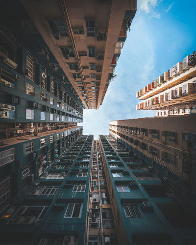 Looking up, building, window and architecture photo in hong kong.