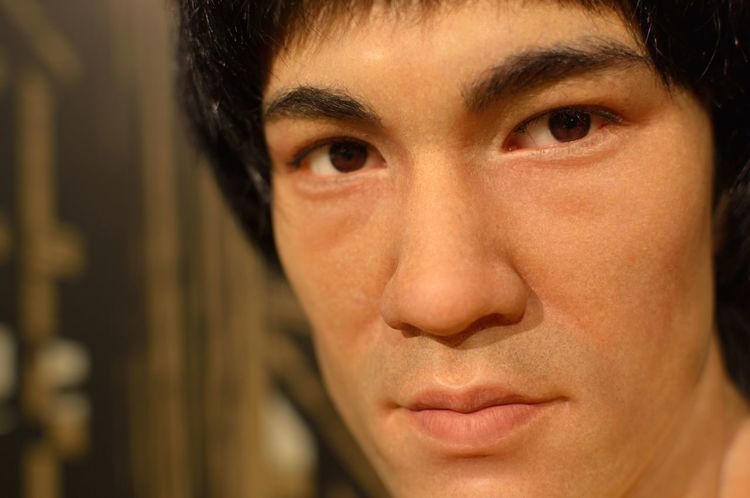 Bruce Lee Close-up Confidence  Contemplation Depth Of Field Front View Happiness Head And Shoulders Headshot Holding Human Body Part Human Face Human Hand Lifestyles Looking At Camera Madame Tussauds Person Portrait Real People Selective Focus Serious Wax Dolls Wax Museum Young Adult