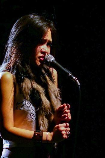 Young woman singing at nightclub