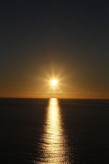 Beautiful Beauty In Nature Horizon Over Water Idyllic Nature Reflection Scenics Sea Silhouette Sky Sun Sunlight Sunset Tranquil Scene Tranquility Water Waterfront