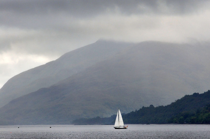 A yacht sailing on Loch Linnhe, Fort William, Scotland Weather Cloud - Sky Loch Linnhe Mode Of Transportation Mountain Mountain Range Nautical Vessel No People Non-urban Scene Outdoors Sailboat Sailing Sky Tranquil Scene Tranquility Transportation Water Yacht