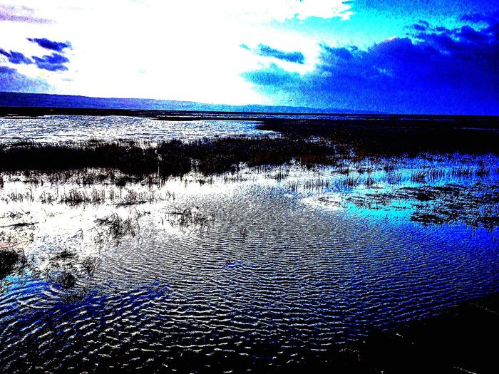 High High Tide 2018 New Year 2018 Water Nature Beauty In Nature Cloud - Sky Sky Scenics Shades Of Winter No People Tranquility Tranquil Scene Reflection Outdoors Landscape Blue