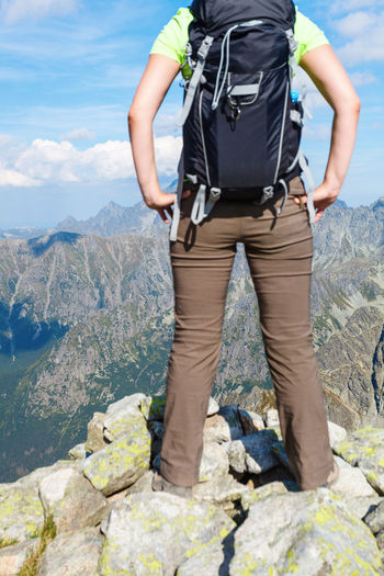 Woman with backpack standing on the edge, looking at mountains (Tatra Mountains Carpathian Mountain Range, Europe) Active Lifestyle  Admiring The View Adventure Backpack Disconnect Disconnected Exploring FAR AWAY Hiking Leisure Activity Lifestyle Lonely Looking Mountain Mountain Range Nature One Person Outdoors Relax Rucksack Tourism Tourist Unplugged Vacation Woman
