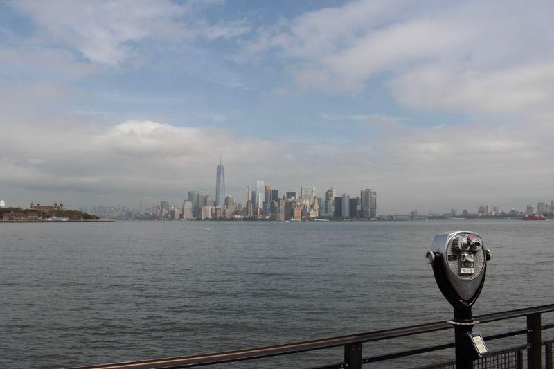 Coin operated binoculars with city in distant