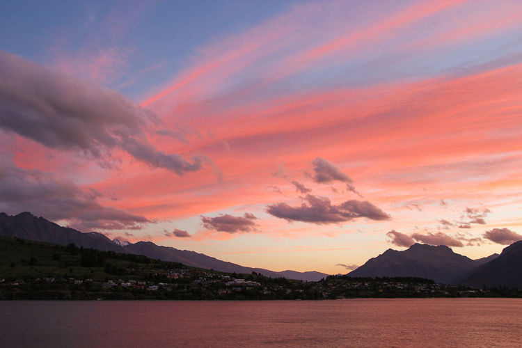 In early morning of summer before sunrise, with clouds sky becomes rosy and blue over Lake Wakatipu, Queenstown, New Zealand. Clouds Colors Dark Daybreak Floating Lake Lake View Landscape Mountains New Zealand Orange Color Pink Queenstown Rosy Sky South Island Sunrise Travel Water Weather