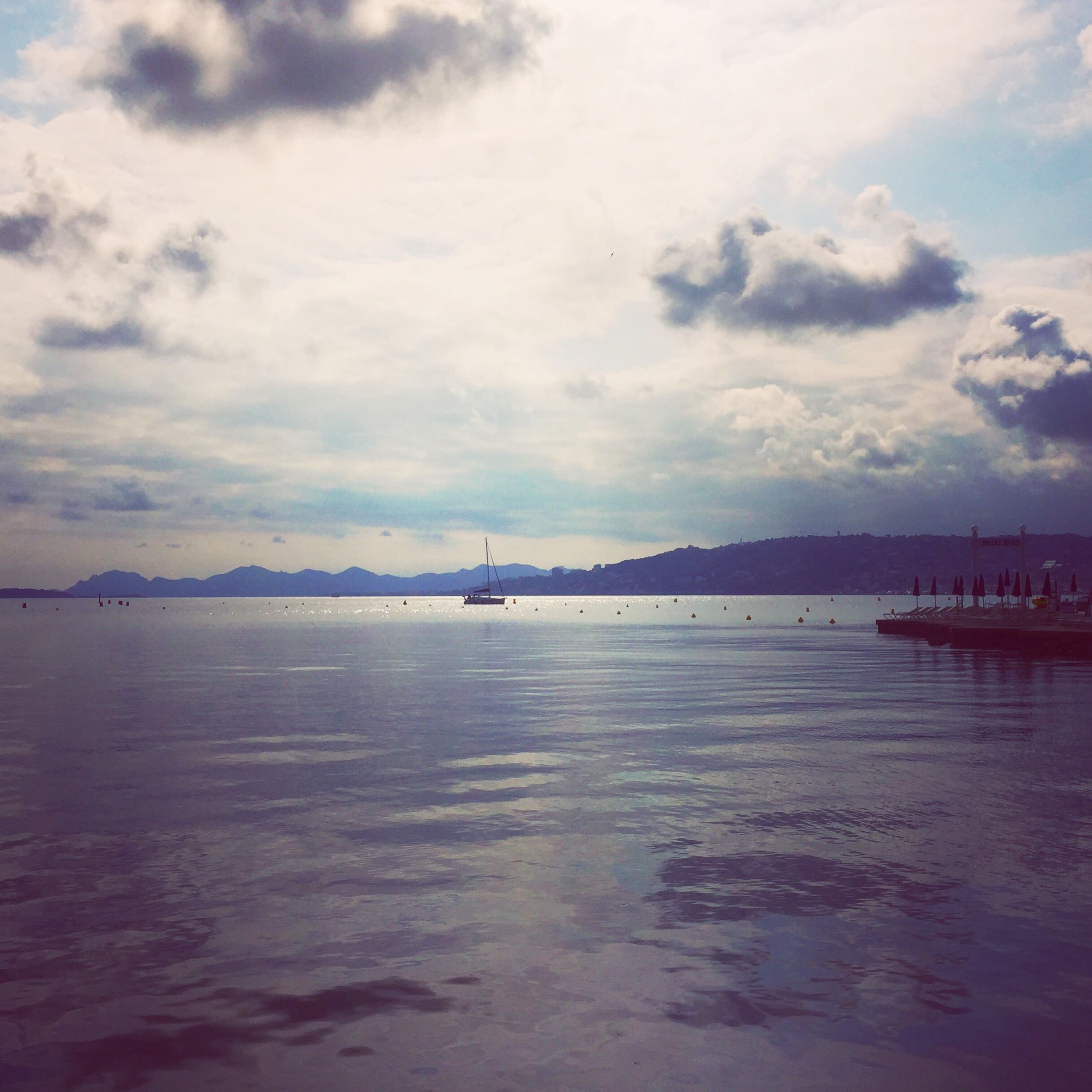 water, sky, tranquil scene, cloud - sky, sea, scenics, reflection, beauty in nature, tranquility, nature, outdoors, no people, day, beach