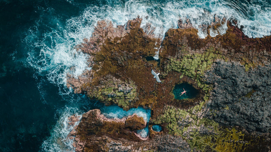 Aerial view of sea and rock formations