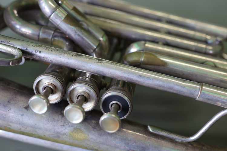 Baritone instrument Marching machine is made of beautiful silver plated brass. Old Vintage Classical Music Manufacturing Equipment Wind Instrument Musical Instrument Music Metal Industry Arts Culture And Entertainment Metal Close-up Historic Rusty Discarded Worn Out Run-down Bad Condition Obsolete Shipwreck Ruined Junkyard Damaged Peeling Off Abandoned Deterioration Latch Machine Historic Building Weathered Loom