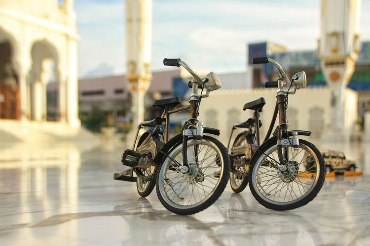 Architecture Aceh Transportation Mode Of Transportation Bicycle Land Vehicle Focus On Foreground Stationary Day City No People Built Structure Building Exterior Outdoors Street Travel Building Reflection Nature Wheel Parking