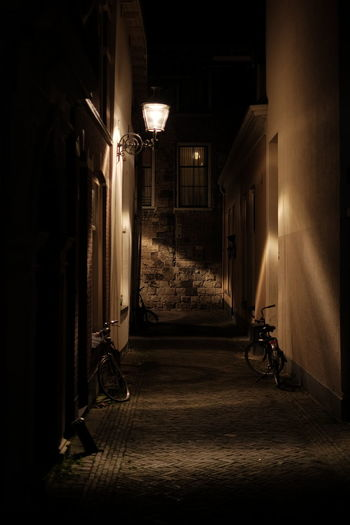 Absence Alley Architecture Built Structure Dark Diminishing Perspective Electric Lamp Empty Glowing Illuminated Lighting Equipment Narrow Night No People The Way Forward Walkway