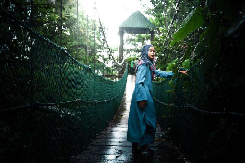 Beauty In Nature Canopy Walk Muslimah Nature One Person Outdoors Tree Women Around The World Long Goodbye The Secret Spaces Long Goodbye Live For The Story Woman In Hijab Hijab