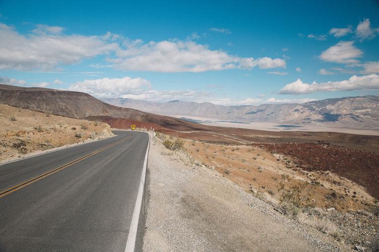 View Of Road On Desert Against Sky
