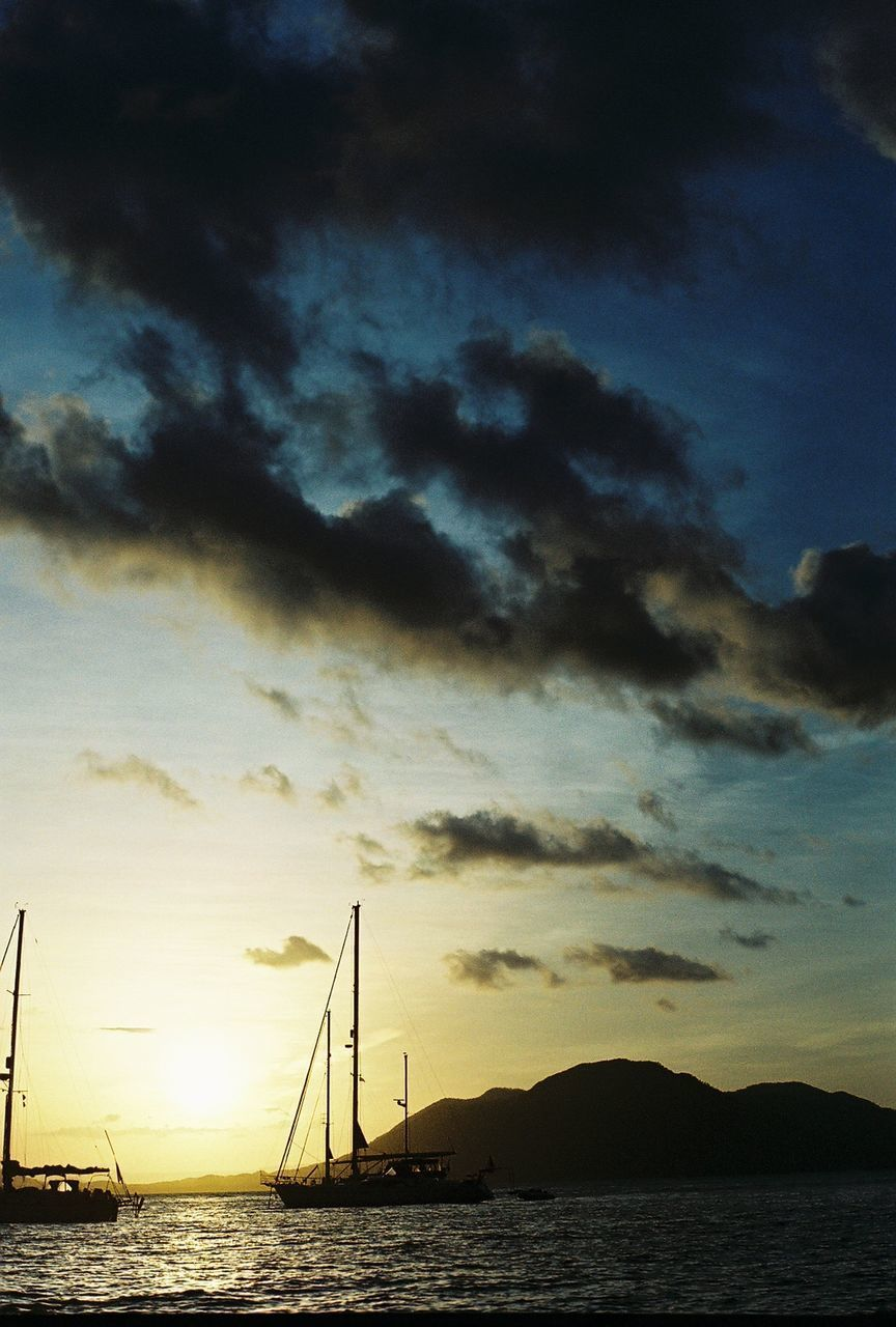 sky, sunset, scenics, cloud - sky, water, beauty in nature, tranquil scene, tranquility, nature, sea, silhouette, no people, outdoors, nautical vessel, waterfront, transportation, mountain, travel destinations, sailboat, mast, day