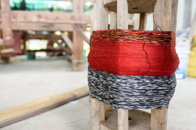 Architectural Column Architecture Art And Craft Close-up Craft Creativity Day Focus On Foreground Indoors  Material No People Pattern Red Spool Still Life Table Textile Thread Wood - Material Wooden Post Wool