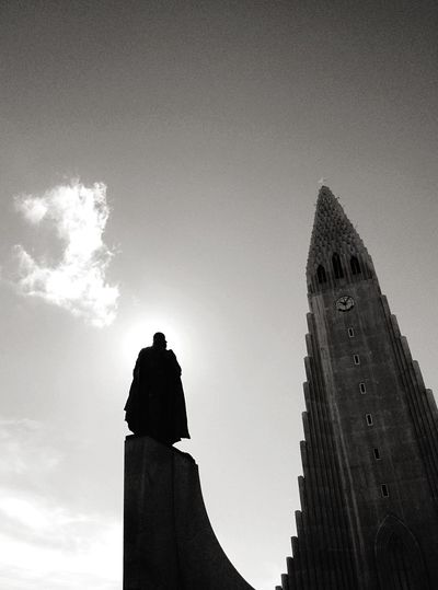 Low Angle View Of Silhouette Statue By Hallgrimskirkja Against Sky