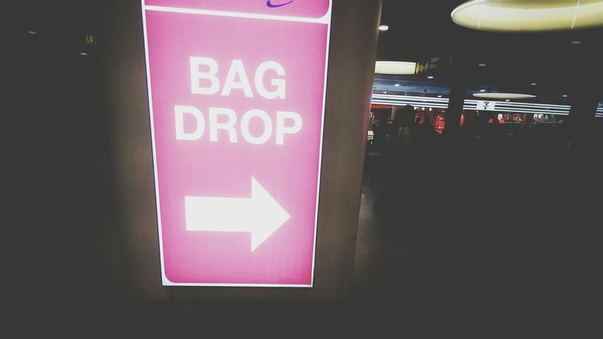 Pastel Power at the baggage drop off Sign in Copenhagen. Eye4photography  Airport No People Holiday Vacation Details Directional Sign Direction Information Sign Letters Baggage Airports Baggage Claim Pink Pink Color Arrow Arrow Symbol Guidance Traveling Starting A Trip Focus On Foreground Copenhagen