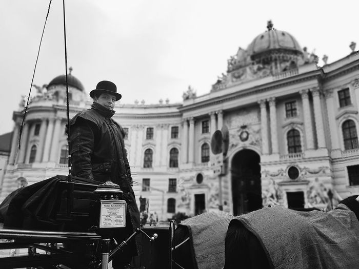 Daily Vienna in BW EyeEm Selects Travel Destinations History Architecture Building Exterior Only Men People One Man Only Outdoors City Day Built Structure Travel Bw_ Collection Bw_collection Blackandwhite Vienna Vienna, Austria Carriage