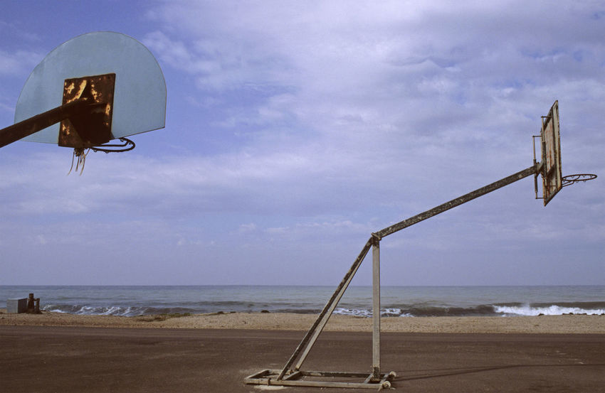 abandoned playground in front of the sea, Andalucia, Spain Abandonment Analogue Photography Andalucía Basketball Court Mediterranean  SPAIN Abandoned Absence Basketball Hoop Beach Coast Deserted Europe Horizon Over Water No People Outdoors Playground Run-down Sea Seafront Sky Tranquil Scene Tranquility Waterfront