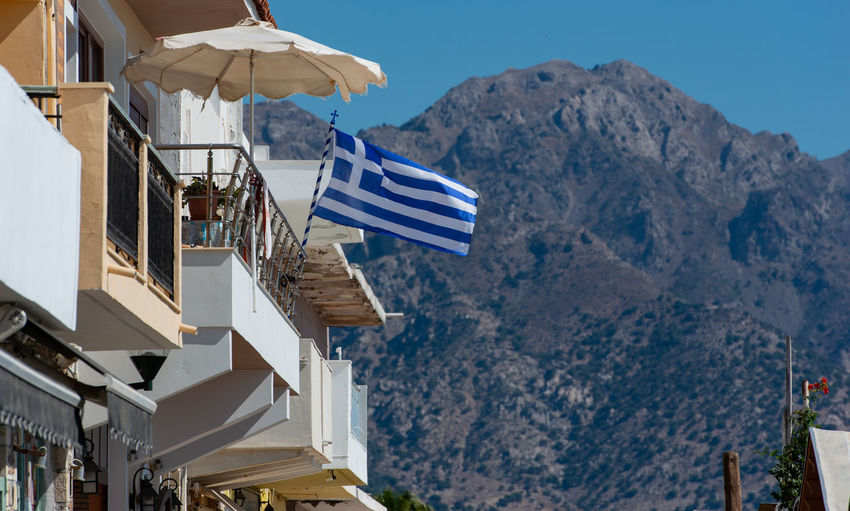 Greece flag on a building in kardamaina kos
