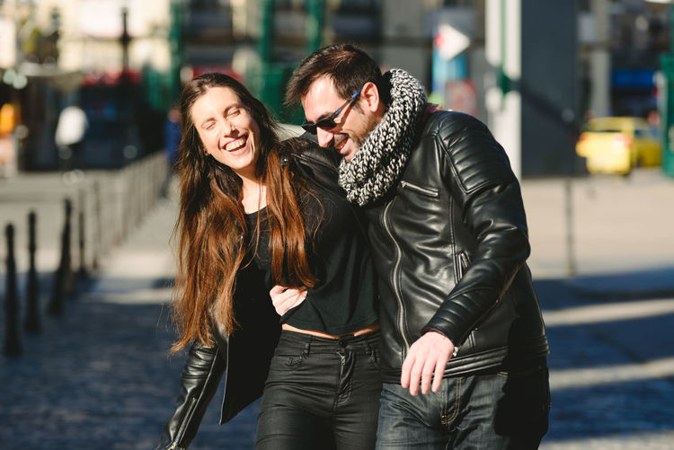 Couple standing in city