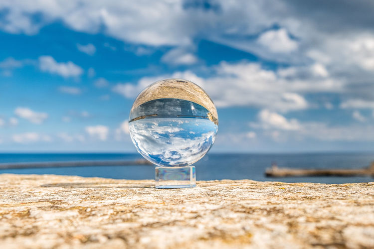 Crystal sphere against sky and sea
