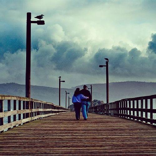 Love on a Pier . Instalove Affection Northernca Crescentcityca Walk Stroll Beach Beauty Seagull Birds Clouds Storm Turbulent Instaweather Instagood