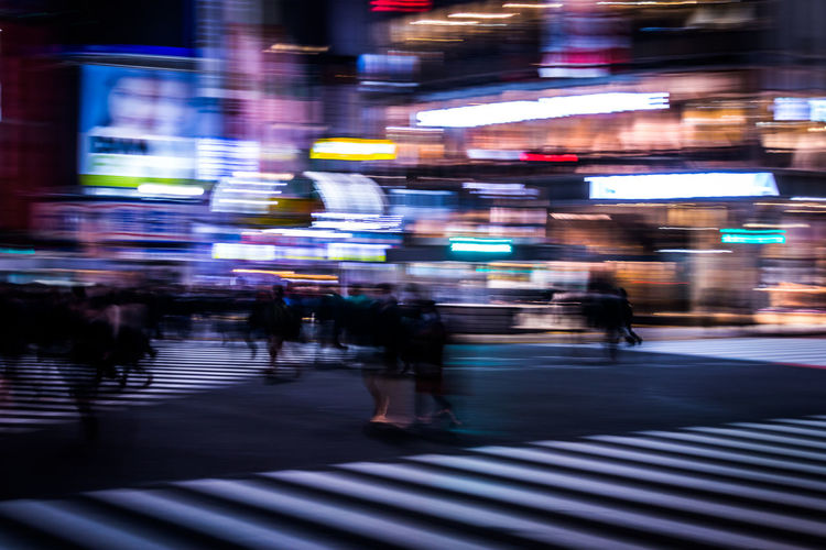 Business Finance And Industry Business Technology Tech Acceleration Business Acceleration Neon Futuristic Development Revolution Algorithm Analytics Speed Transportation Japan Tokyo Intersection Zebra Crossing Shibuyascapes Blurred Motion Motion Blur Street Abstract People City Architecture City Life Crosswalk Illuminated Night Motion Real People Crossing Building Exterior Group Of People Walking Built Structure Road Marking City Street Road Outdoors Rain Humanity Meets Technology My Best Photo