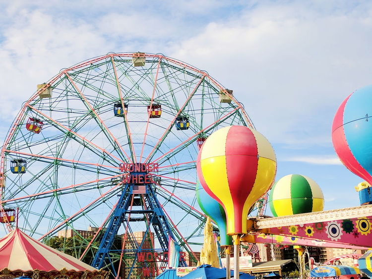 Perfect Day for the Carnival Amusement Park Arts Culture And Entertainment Multi Colored Ferris Wheel Amusement Park Ride Sky Hot Air Balloon Traveling Carnival Fun Cloud - Sky Low Angle View Outdoors No People Day Adventure Ballooning Festival carnival ferris wheel Festival carnival big tent balloons hot balloons