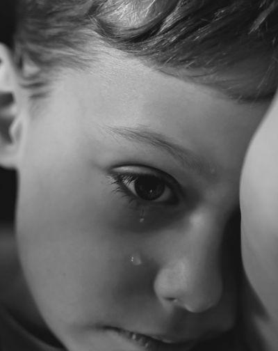 Close-up of boy crying at home