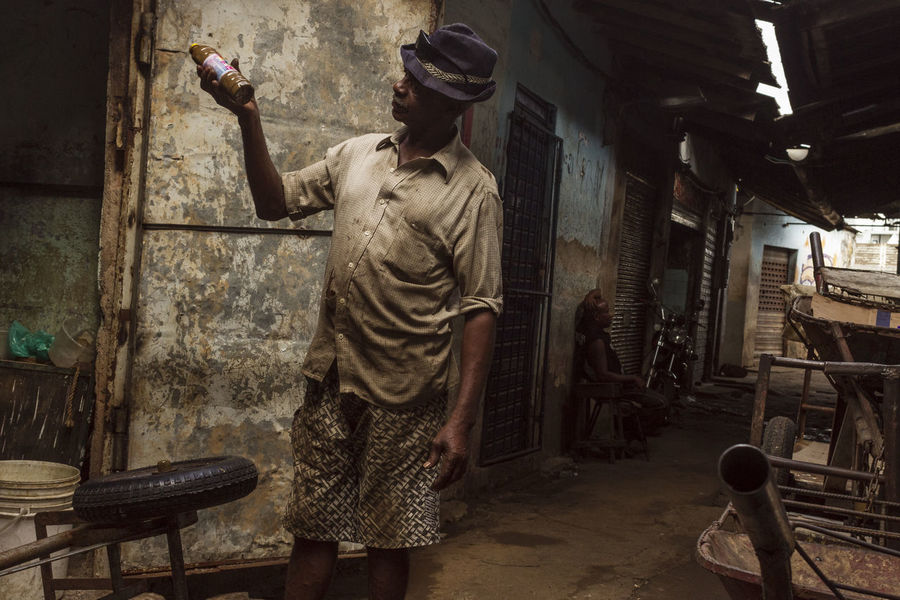 Alleyway Chiaroscuro  Holding Light And Shadow Manual Worker Men Real People Standing Subtlelight Working