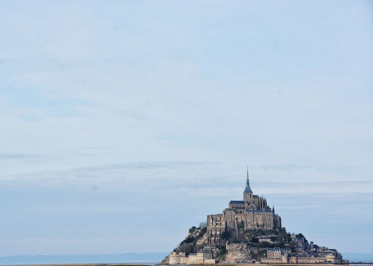 Historic mont saint-michel against sky