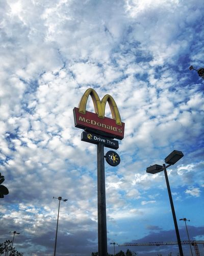 McDonald's McDonald Communication Text Western Script Sky Cloud - Sky Low Angle View Day Guidance No People Outdoors Road Sign Nature McDonald's Signs