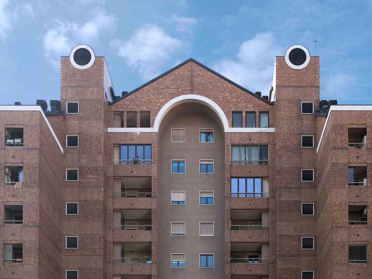Arch Architecture Balconies Brick Wall Building Building And Sky Building Exterior Built Structure Chimneys City Cloudy Sky Day Design Building Glass Windows No People Outdoors Porthole Redbrick Roof Simmetrical Building Sky Sunny Building Terraces Windows
