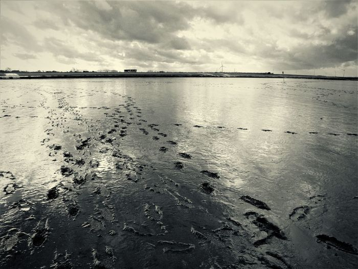 Watt Reflection Storm Beauty In Nature Blackandwhite Cloud - Sky Day Marks Mud Flat Nature No People North Sea Outdoors Scenics Sea Sky Tone Splitting Tranquil Scene Tranquility Water Waterfront
