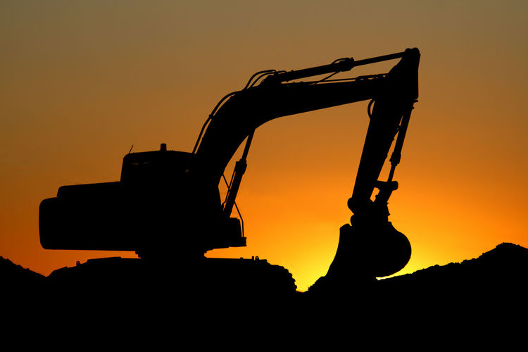 Excavator Back Lit Construction Machinery Excavator No People Orange Color Outdoors Road Construction Silhouette Sky Sunset
