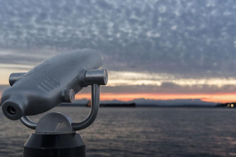 Monocular pointed at the sunset sky over Elliott bay, Seattle Wa Binoculars Dramatic Sky Monoculars No People Park Seattle Sky Summer Sunset Telescope Waterfront