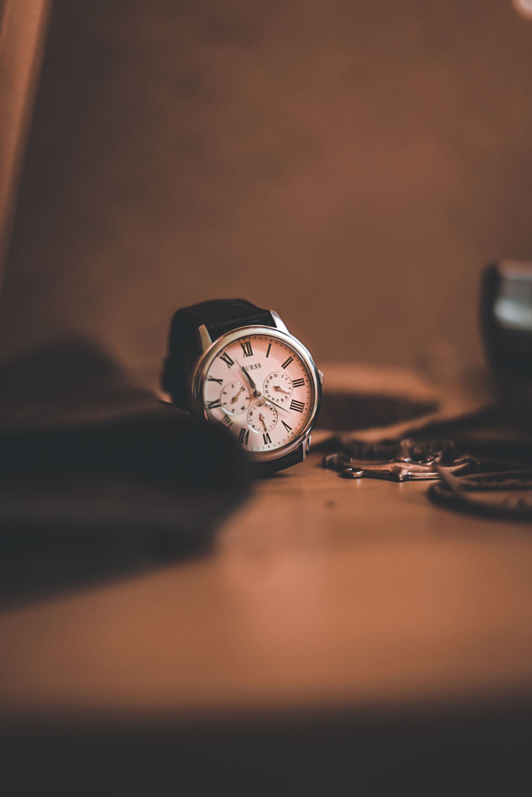 watch, time, close-up, clock, black, light, hand, indoors, wristwatch, selective focus, instrument of time, darkness, yellow, macro photography, still life, accuracy, metal, table