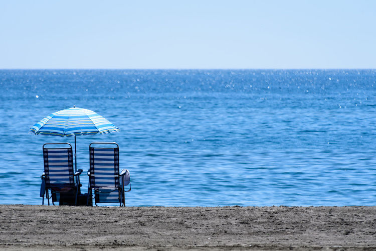 Beach lounger against the sea under a blue sky. Travel Traveling Beach Beach Lounger Blue Blue Sky Clear Sky Day First Eyeem Photo Horizon Horizon Over Water Mini Outdoors Sand Sandy Scenics Sea Sea And Sky Sky Summer Tranquility Water Waterfront