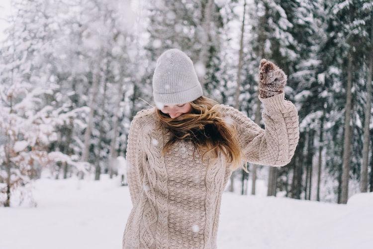 Young woman having fun in the snow