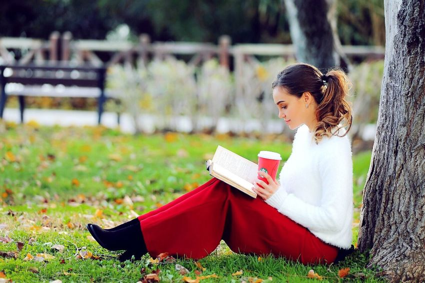Book Reading Education Grass Writing Beautiful People Sitting Learning Green Color Young Adult One Person Outdoors Autumn Beauty Beauty In Nature Nature