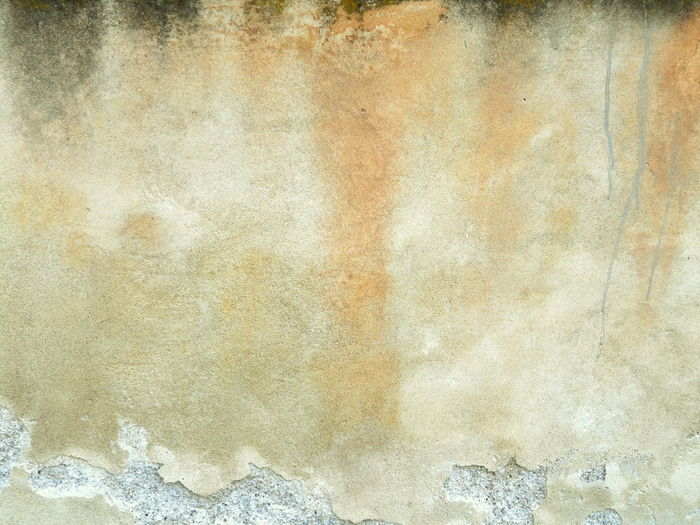 Weathered cracked and moulded concrete wall background Abstract Abstractart ArchiTexture Backgrounds Bad Condition Beige Black Brown Cement Concrete Weathered Wall Dirty Grunge Grungy Textures Italy Moulded Orange Plaster Plastered Rough Scratched And Cracked Wall Shades Of Grey Stained Stains And Cracks Textures And Surfaces Yellow