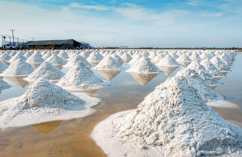 Sea salt farm and barn in thailand. organic sea salt. raw material of salt industrial. sodium.