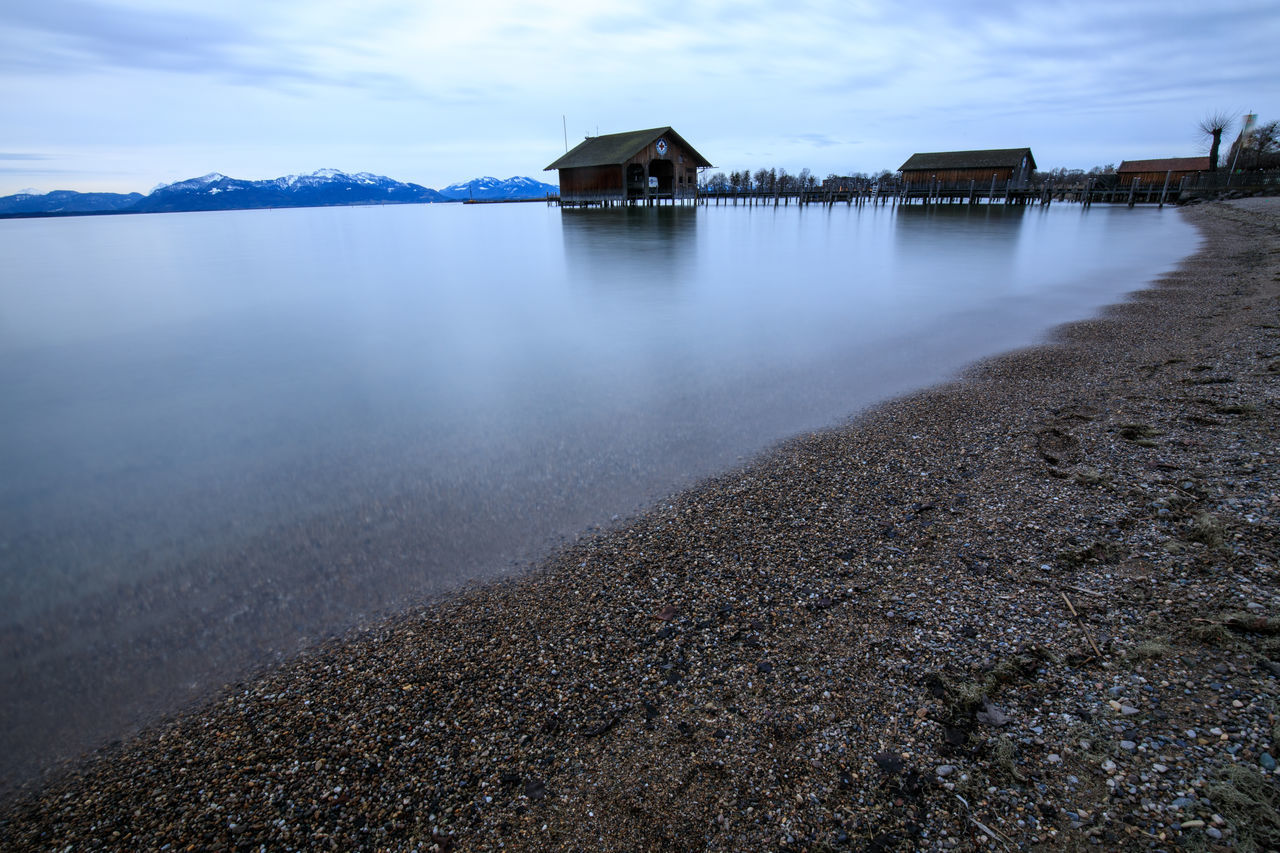 built structure, water, architecture, sky, tranquil scene, house, tranquility, outdoors, no people, beauty in nature, scenics, beach, building exterior, nature, sea, day