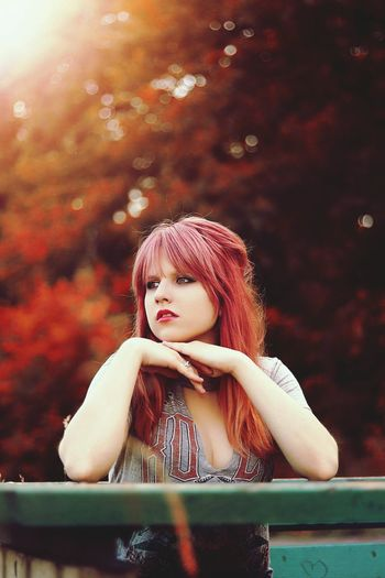Thoughtful Beautiful Young Woman With Redhead Looking Away While Standing By Railing