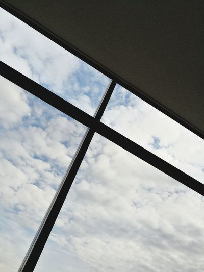 Low angle view of sky seen through window