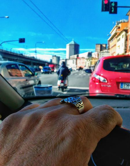 Human Hand Human Body Part Car Transportation One Person Personal Perspective Human Finger Mode Of Transport Adults Only Driving Vehicle Interior Car Interior Close-up Holding Real People Land Vehicle Adult Women People Day Car Driving Silver Ring From Car