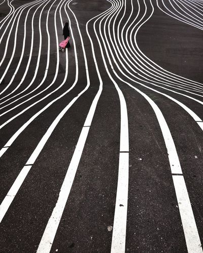 High angle view of woman on patterned road
