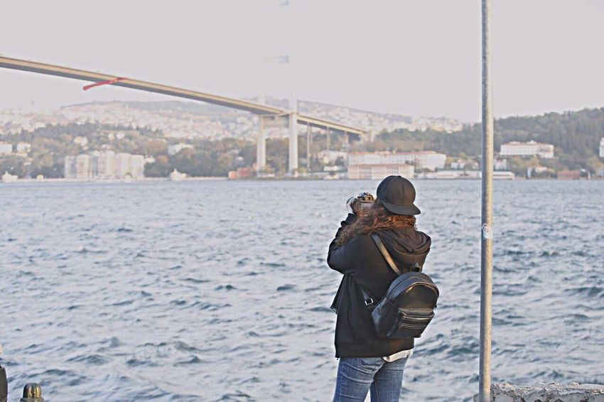 My Year My View One Person Videographer Silent Moment Nature Beatuy Auntumn Hat City Standing Warm Clothing Rear View Portable Information Device Smart Phone Day Outdoors Winter Connection Bridge - Man Made Structure Cityscape Black Istanbul Turkey Istanbul Istanbul - Bosphorus Women Around The World Welcome To Black TCPM