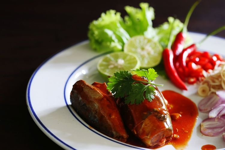 Thai food famous for canned fish Hungry Yummy Food Lunch Time! Dinner Delicious Still Life Style Wood Table Background Chilli Cooking Popular Fish Can Canned Fish Lime Lemon Grass Onion Plate Gourmet Healthy Lifestyle Seafood Food Styling Close-up Food And Drink